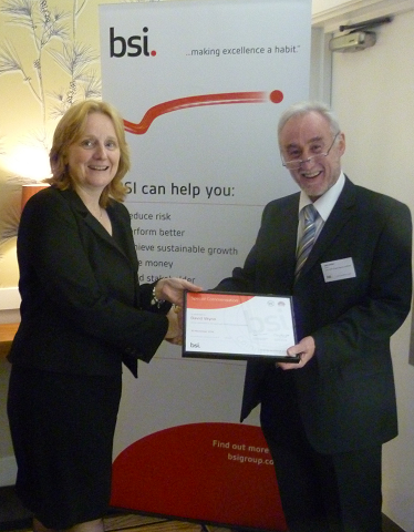 Picture of Dave Wynn being awarded the special commendation from the BSI