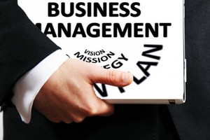 Picture of a man carrying a business management folder
